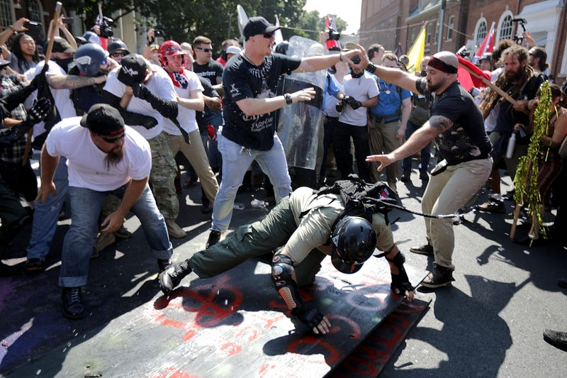 "White nationalists, neo-Nazis and members of the ""alt-right"" clash with counterprotesters during the ""Unite the Right"" rally August 12, 2017 in Charlottesville, Va."