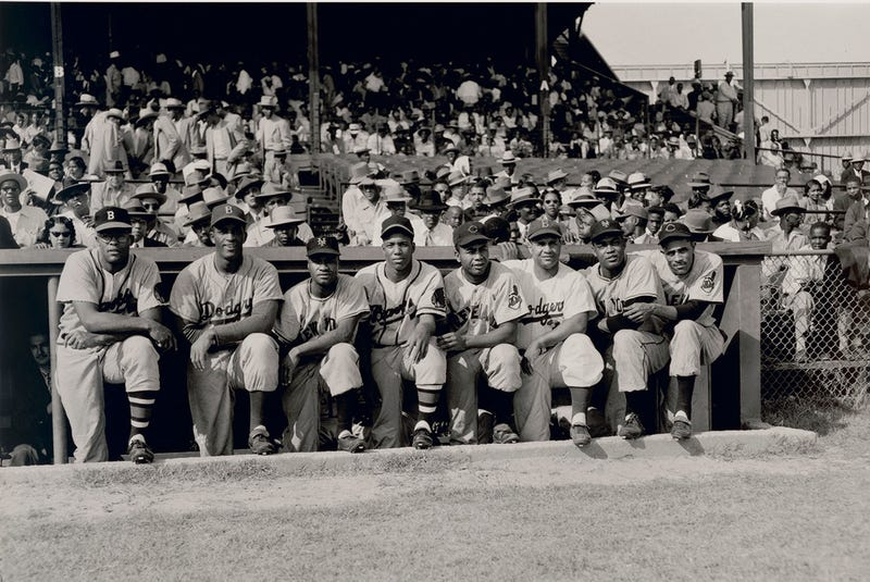 "Eight black MLBers photographed at a Negro League Alumni All-Star Game in 1952. L-R: George Crowe, Joe Black, Hank Thompson, Sam Jethroe, Larry Doby, Roy Campanella, Monte Irvin, and Harry ""Suitcase"" Simpson."