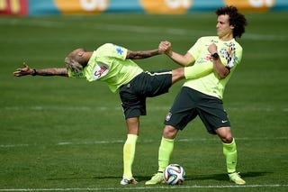 Illustration for article titled Dani Alves And David Luiz Love Stretching Together Very Awkwardly