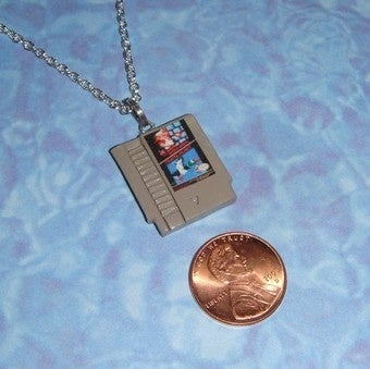 "Illustration for article titled Custom Make ""Any Game"" as an NES Cart Necklace Charm"