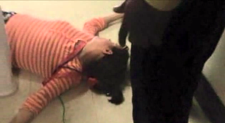 Screenshot from surveillance video showing Hempstead, N.Y., teacher Catherine Engelhardt on the floor after being knocked outWABC