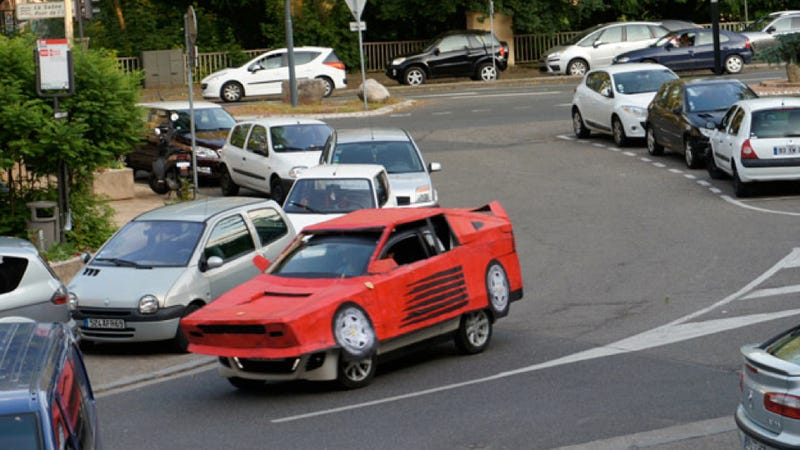 Illustration for article titled French Artist Has A Fantastic Way To Turn Any Car Into A Ferrari