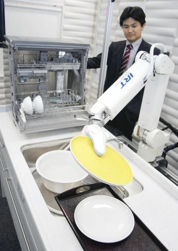 Illustration for article titled Robot Rinses Dishes, Puts them In Dishwasher