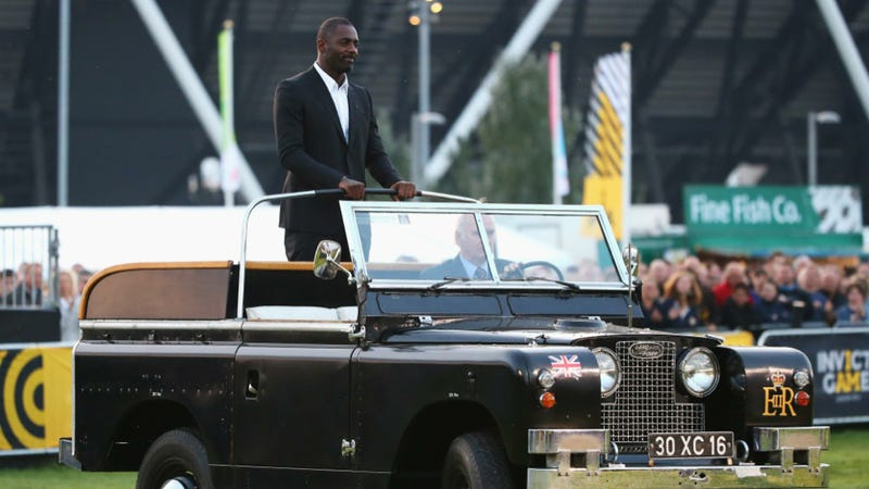 Illustration for article titled Here's Idris Elba Riding A Land Rover Like It's A Preppy War Chariot