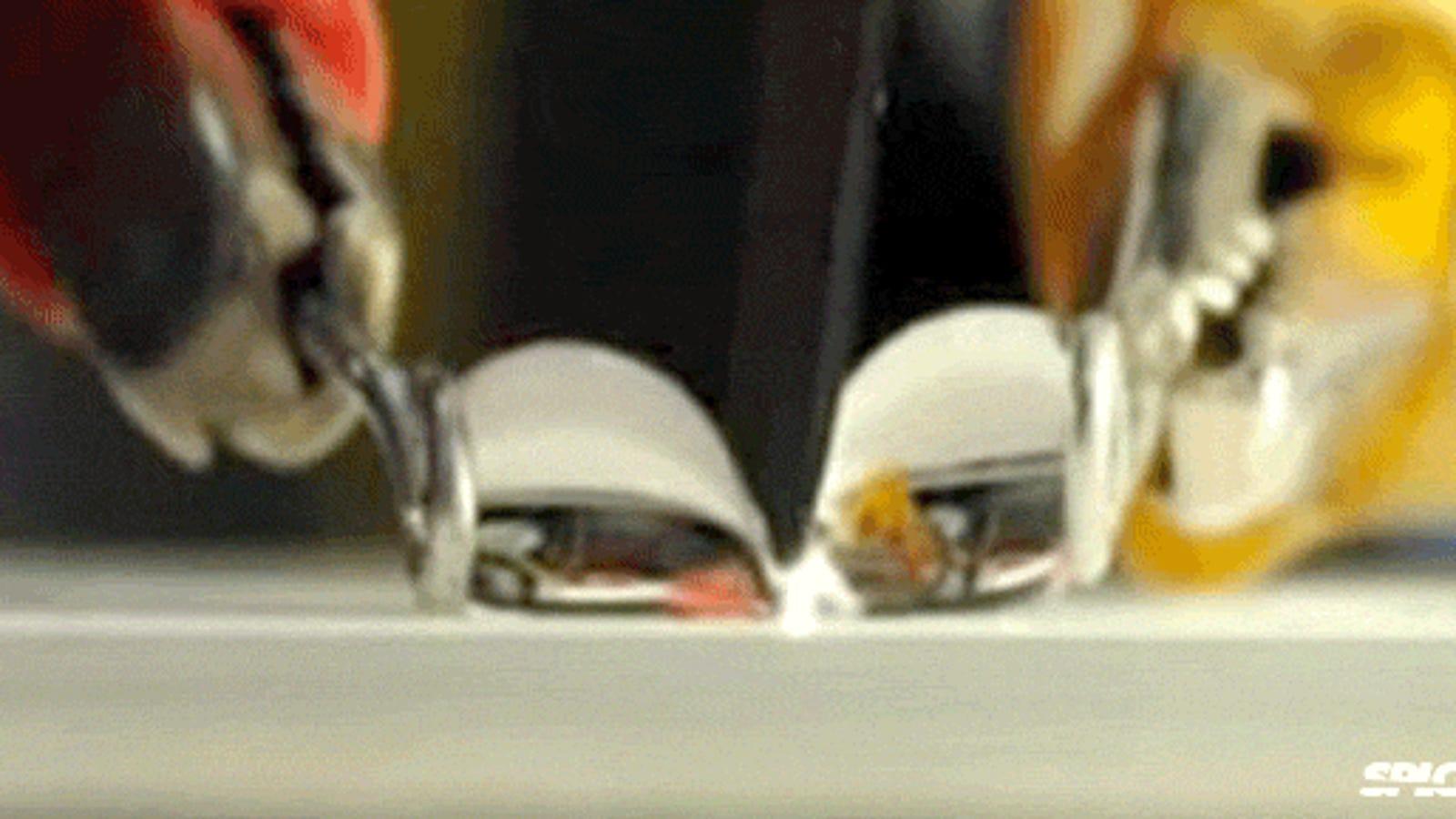 Watch a super hydrophobic knife cut through a water droplet