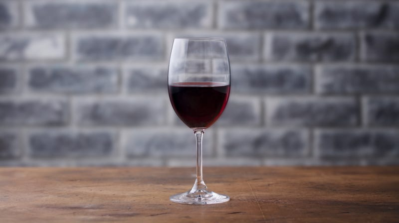 Illustration for article titled Study: A small glass of red wine daily could be good for your gut