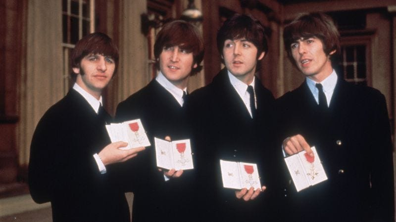 The Beatles, shortly after accepting their MBEs from Queen Elizabeth in 1965. (Photo: Hulton Archives/Getty Images)