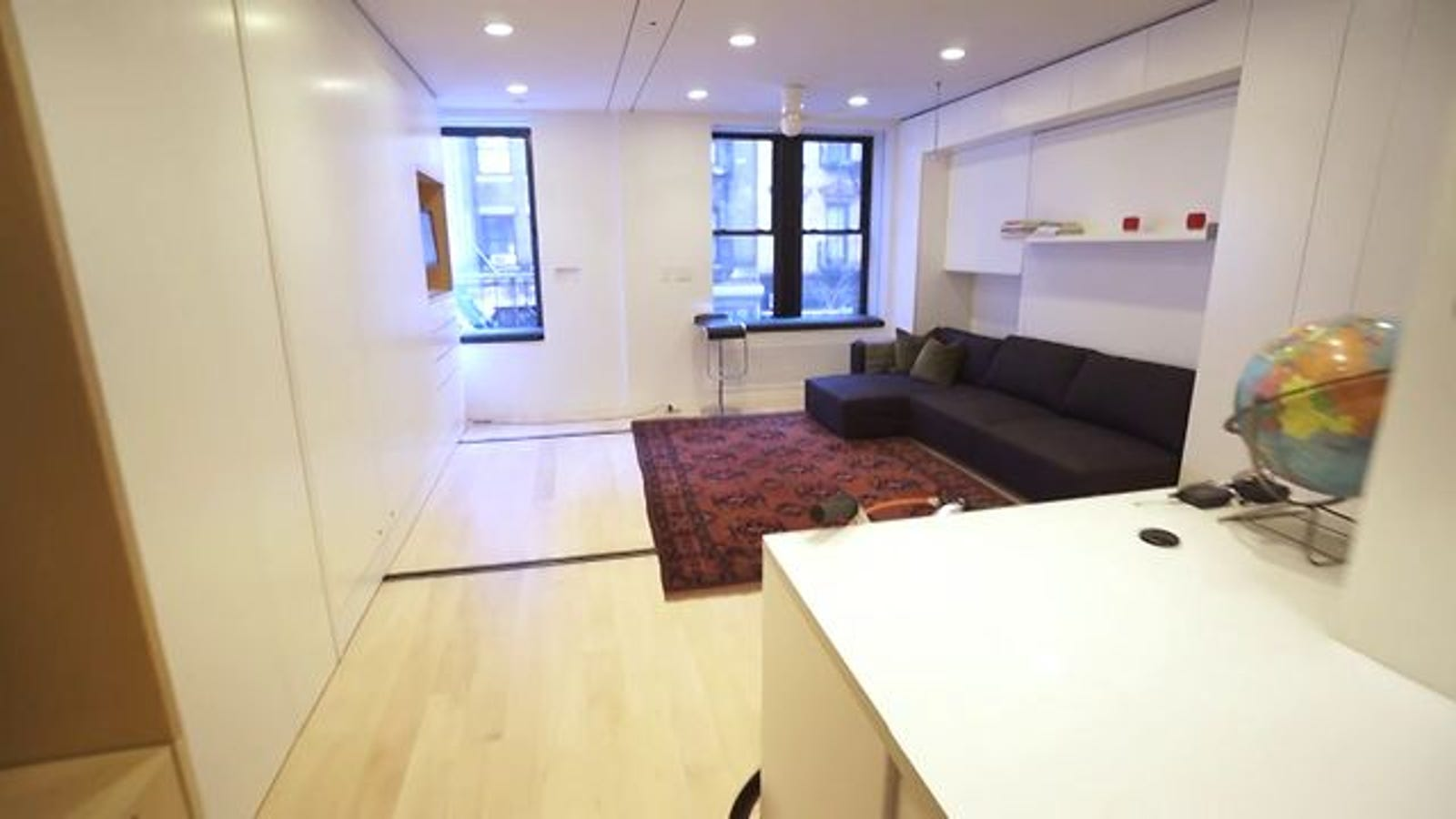 The Tiny Transforming Apartment That Packs Eight Rooms into 420 Square Feet