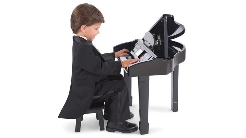 Illustration for article titled Kid-Sized Baby Grand Teaches Wannabe Schroeders