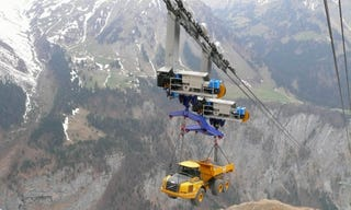 Illustration for article titled Truck transported on a ropeway going up a 5,400-foot mountain