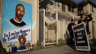 Activists look at a mural of Ezell Ford, a 25-year-old mentally ill black man, at the site where he was shot and killed by two police officers Aug. 11, 2014, in Los Angeles.David McNew/Getty Images