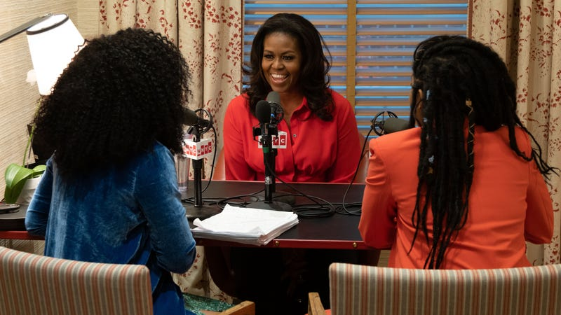 Phoebe Robinson (l) and Jessica Williams with former First Lady Michelle Obama (center).
