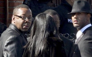 Bobby Brown (left) outside Houston's funeral (Getty)