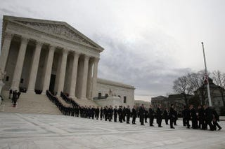 Law clerks past and present line the steps as the casket of Associate Justice Antonin Scalia is carried by U.S. Supreme Court police officers up the steps of the Supreme Court Building in Washington, D.C., Feb. 19, 2016.Mark Wilson/Getty Images