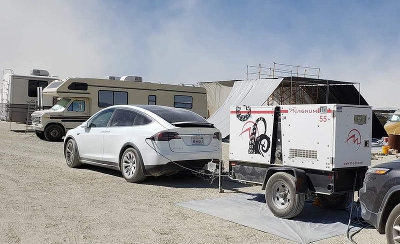 Illustration for article titled Tesla Model X Hybrid Spotted at Burning Man
