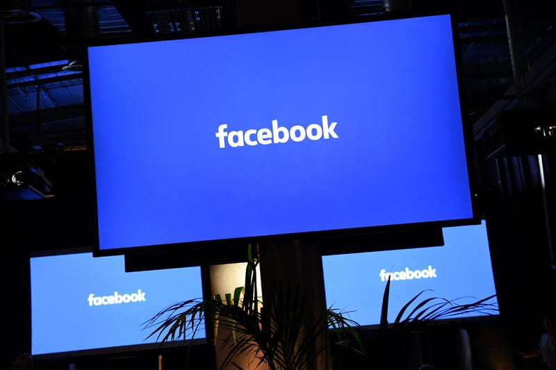 A Facebook logo is pictured on a screen in London on Oct. 10, 2016.JUSTIN TALLIS/AFP/Getty Images