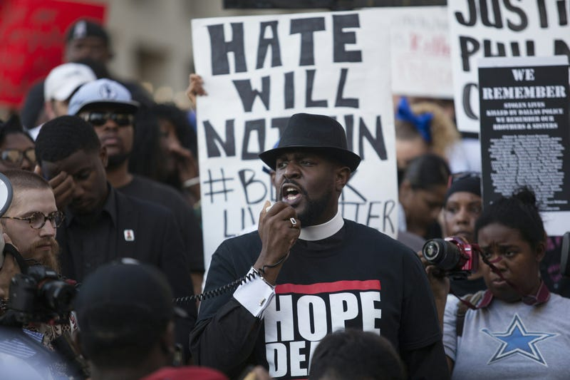People rally in Dallas on July 7, 2016, to protest the deaths of Alton Sterling and Philando Castile.LAURA BUCKMAN/AFP/Getty Images