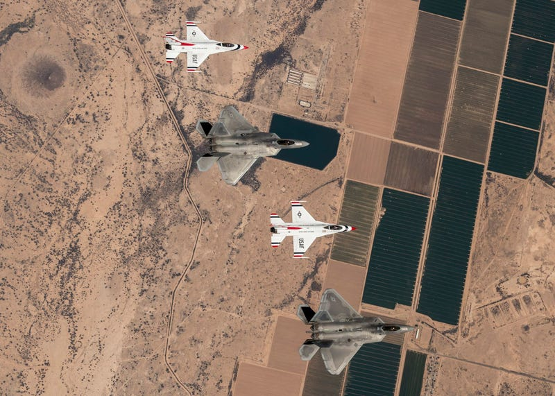 Illustration for article titled These Photos Of Thunderbirds F-16s Flying With F-22 Raptors Is A Whole Lot Of America