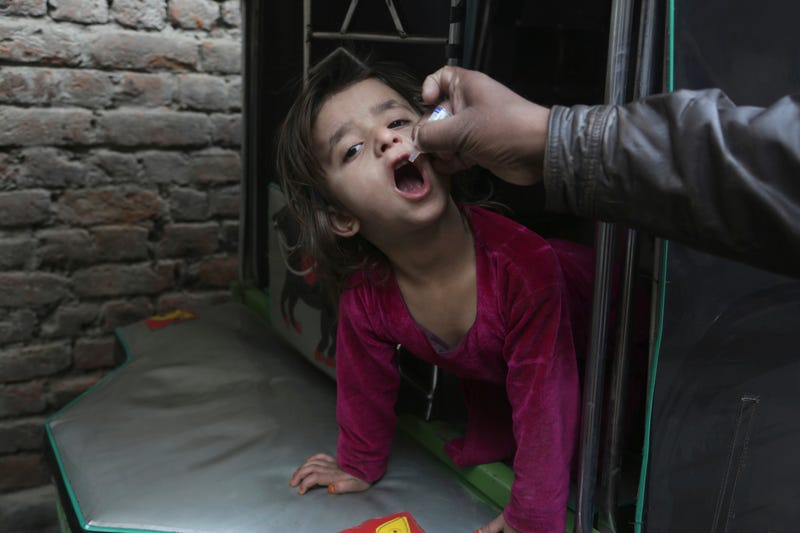 A child receiving the polio vaccine in Lahore, Pakistan, on Tuesday. The the loan to pay for it came in part from Japan, but will likely be repaid by the Gates Foundation. (AP)