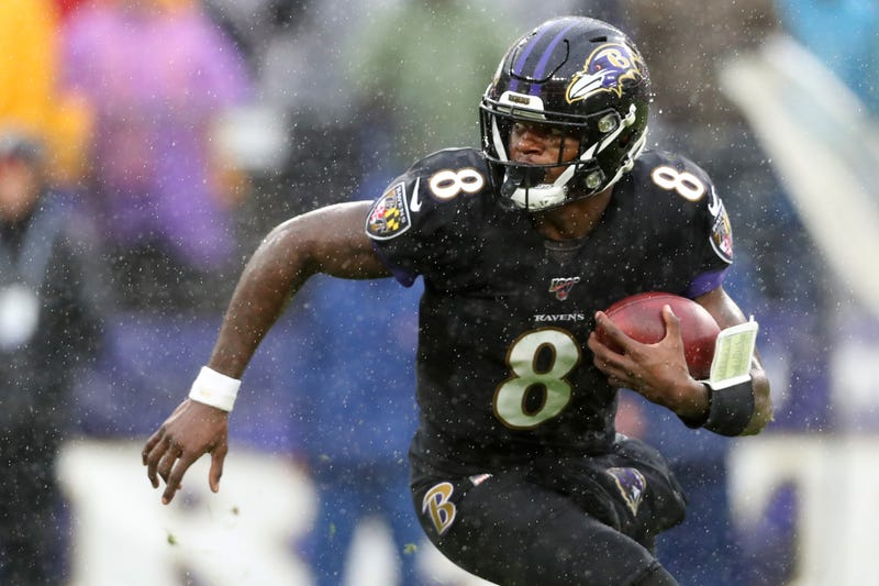 Quarterback Lamar Jackson #8 of the Baltimore Ravens runs with the ball against the San Francisco 49ers in the first half at M&T Bank Stadium on Dec. 1, 2019, in Baltimore.