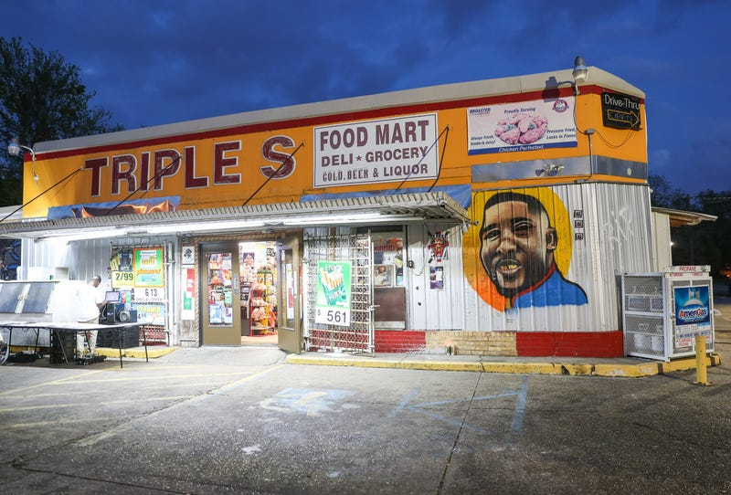 A mural in memory of Alton Sterling is displayed on the wall outside of Triple S Food Mart on March 27, 2018, in Baton Rouge, La. Louisiana Attorney General Jeff Landry announced today that the two officers involved in the July 2016 death of Alton Sterling would not face criminal charges.