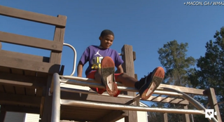 Adam Flowers on the playground with his new Air Jordans13WMAZ