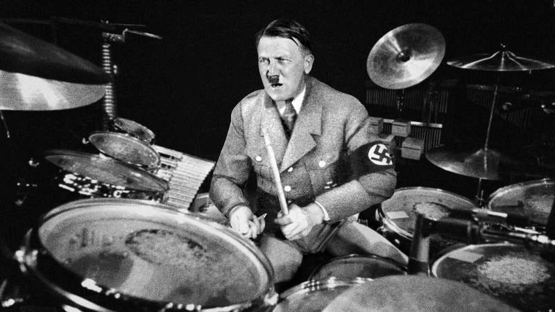 Hitler playing the drums.
