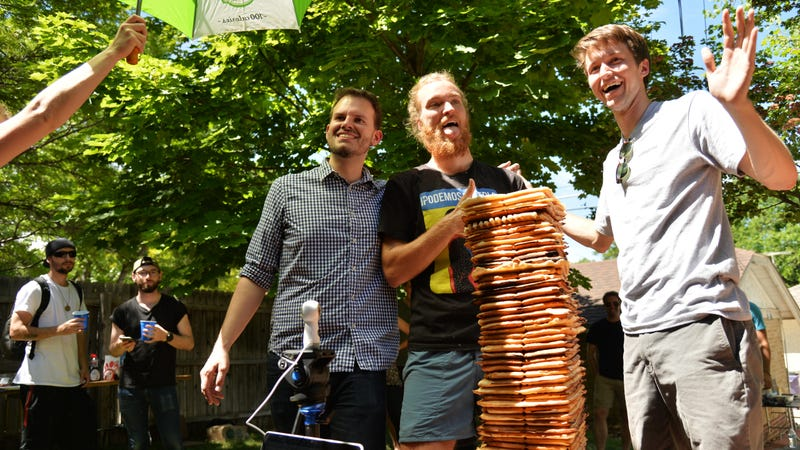 Steve Garguilo, Spencer McCullough, and Cory Trimm celebrate breaking world record for tallest stack of waffles.