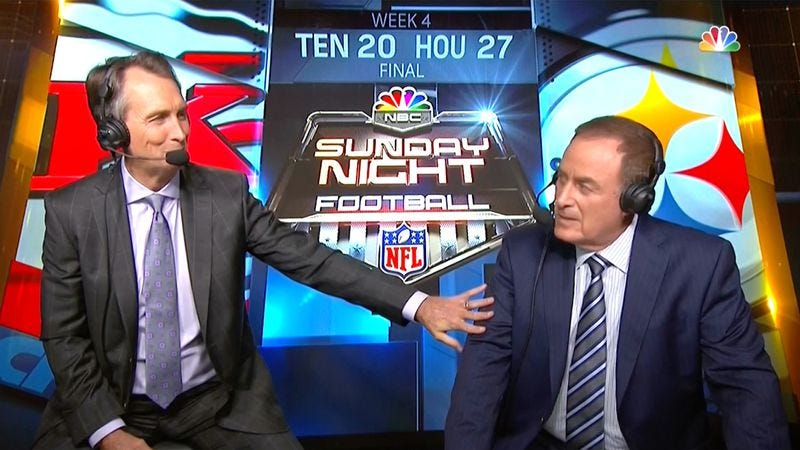 NBC analyst Cris Collinsworth breaches protocol by touching announcer Al Michaels during a Sunday Night Football broadcast. (Screenshot: NBC)