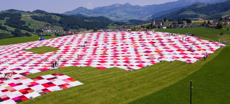 Illustration for article titled The World's Biggest Picnic Blanket Is Growing in the Swiss Countryside