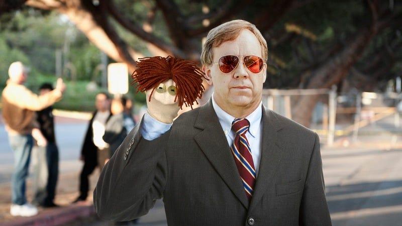 A man holding a puppet