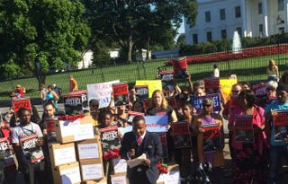 Rashad Robinson speaks to ColorOfChange.org supporters outside the White House Aug. 28, 2014.Diamond Sharp/The Root