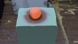 Red hot nickel ball burning through foam breaks the color spectrum