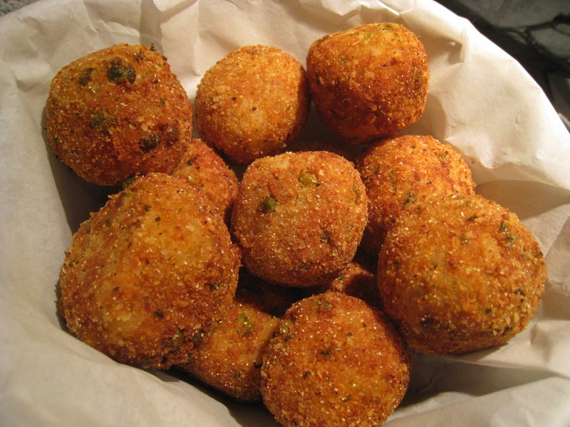 Illustration for article titled Cooking with TAY:  Mozzerella Stuffed, Deep Fried, Risotto Balls (ARANCINI)