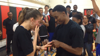 Canadian basketball player Alex Johnson proposes to his girlfriend, former University of North Carolina at Greensboro guard Brey Dorsett, in their own version of Love & Basketball.YouTube
