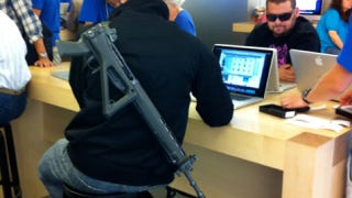 Illustration for article titled Why Does This Guy Have an Assault Rifle at the Apple Store?