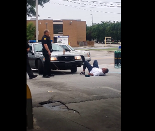 Charles James Lang Jr. lies on the ground after being tased by the unidentified deputy.YouTube screenshot