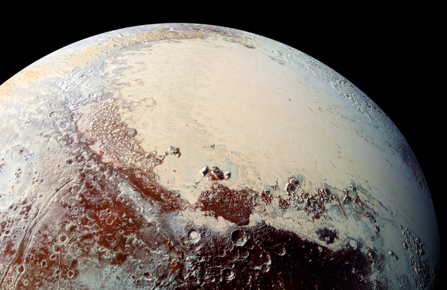 A view of Pluto centered around the icy, crater-free surface known as Sputnik Planitia. Image: NASA/New Horizons