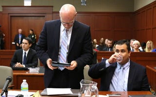 George Zimmerman and Attorney Don West (Joe Burbank-Pool/Getty Images)