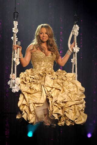"""Illustration for article titled Mariah Cancels New Album; Elin Wears """"Chastity Belt Made Of Spikes"""""""