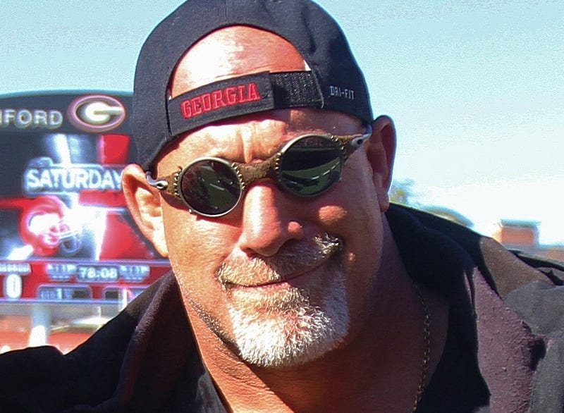 Illustration for article titled How Did UGA Recruit Bill Goldberg? Well, Bourbon Helped.