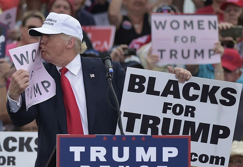 Unusual past for black man behind Trump at Phoenix rally