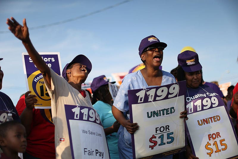 Demonstrators protest to demand an increase in the minimum wage to $15 an hour on April 14, 2016, in Miami.