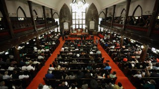 Parishionersgatherinthe historic Emanuel African Methodist Church in Charleston, S.C., on June 21, 2015, four days after a mass shooting killing its pastor and eight others.David Goldman-Pool/Getty Images