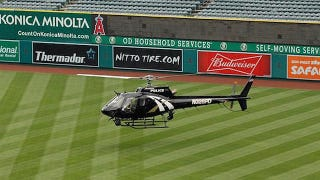 Illustration for article titled The Anaheim Angels Just Used A Helicopter To Dry Off Their Outfield