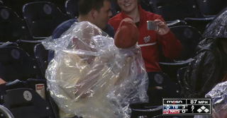 Illustration for article titled Man Trapped In Poncho At Baseball Game