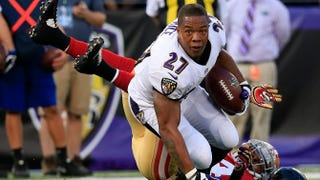 Running back Ray Rice of the Baltimore Ravens loses his helmet after being tackled by strong safety Antoine Bethea of the San Francisco 49ers during the first half of an NFL preseason game at M&T Bank Stadium Aug. 7, 2014, in Baltimore.Rob Carr/Getty Images