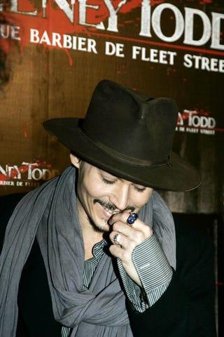 Illustration for article titled Johnny Depp Blushes, Flirts, Smolders