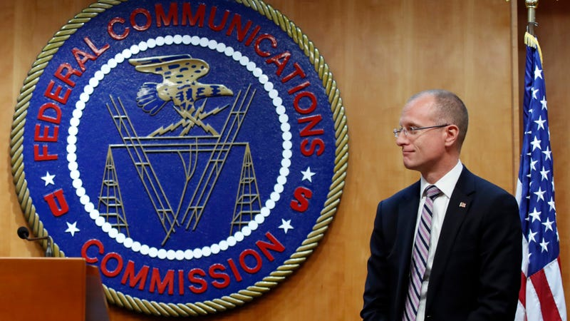 Federal Communications Commission (FCC) Commissioner Brendan Carr answers a question from the media after an FCC meeting to vote on net neutrality, Thursday, Dec. 14, 2017, in Washington.