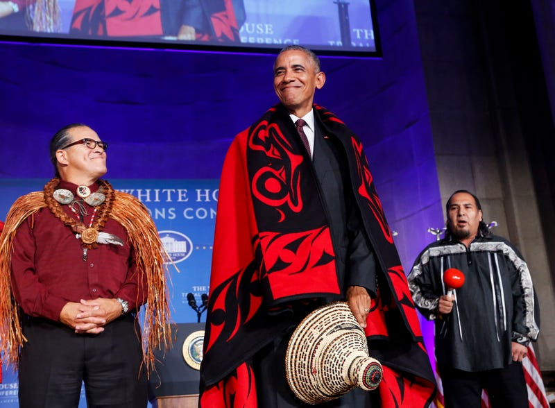 President Barack Obama receives a traditional blanket and hat during the 2016 White House Tribal Nations Conference at the Andrew W. Mellon Auditorium in Washington, D.C., on Sept. 26, 2016.Aude Guerrucci-Pool/Getty Images